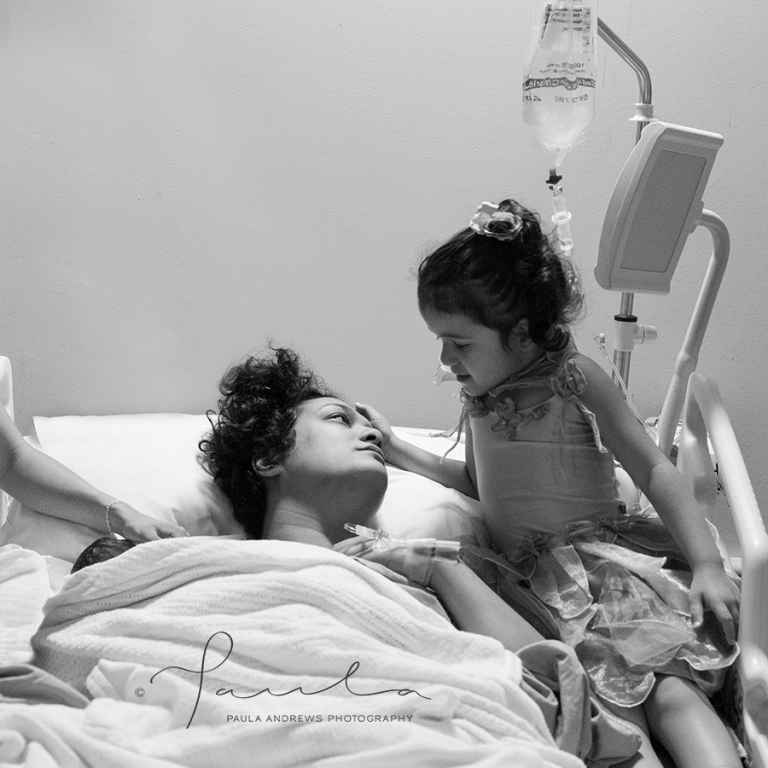 Mother with her 2 children moments after giving birth